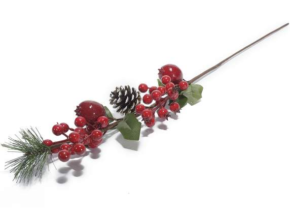 Artificial branches with red berries and pomegranate