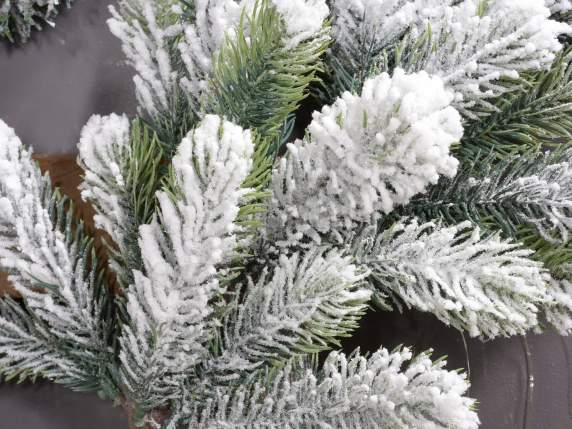 Artificial decorative firs covered with snow