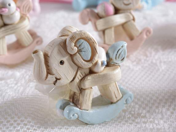 Favor shaped blue baby animals rocking in resin