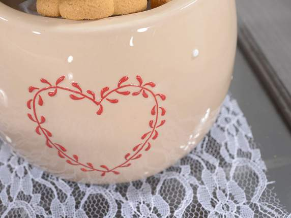 Pottery can with heart decoration