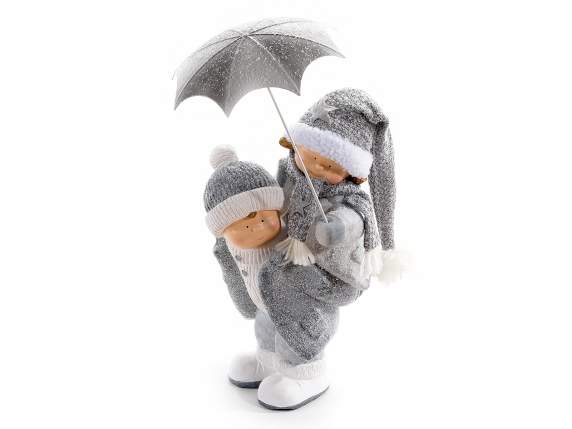 Ceramic children couple w/wool hats and umbrella