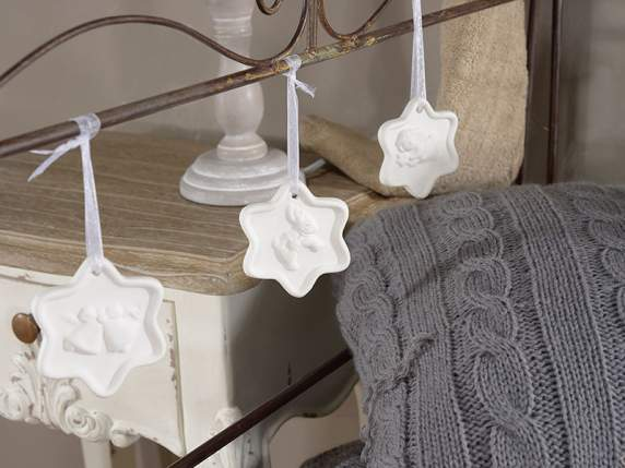 Xmas hanging star in white pottery for decorations