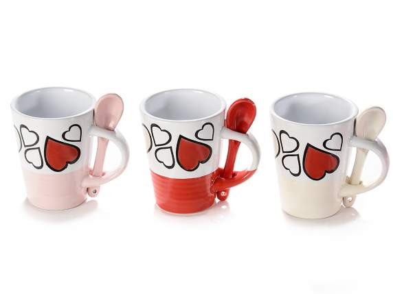 Coffee cups in decorated ceramic and colored teaspoon