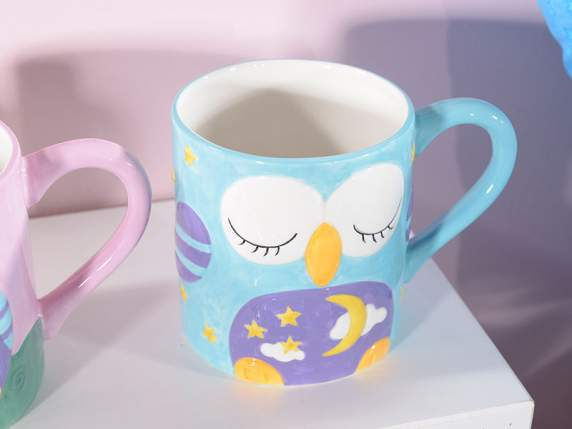 Ceramic cup mug with owl decoration in relief