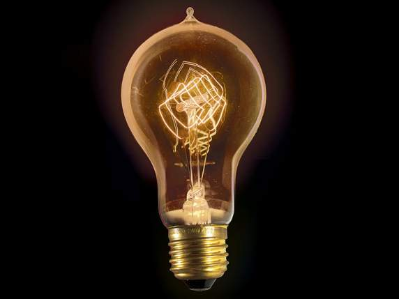 Vintage drop shaped light bulb with rhombus filaments
