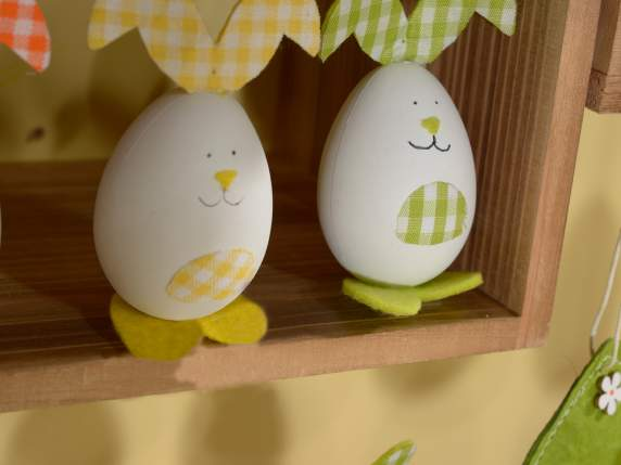 Hanging bunny shaped egg in plastic