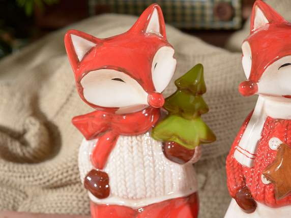 Leaning foxes in coloured pottery