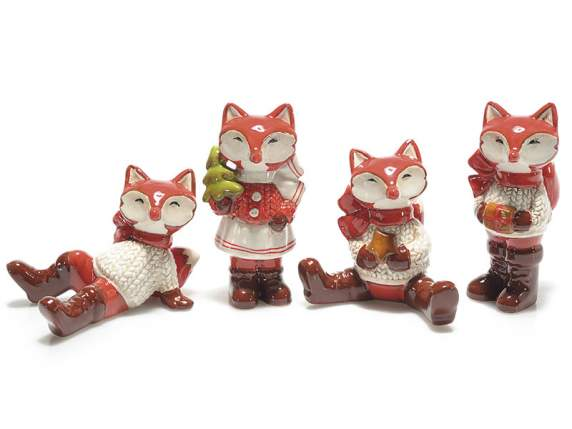 Coloured pottery foxes to lean