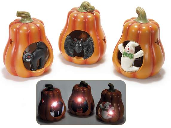 Pumpkins in ceramic with Halloween subjects and light