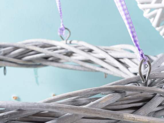 Hanging grey wicker garland with violet ribbon and hook.