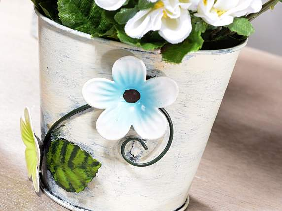 Metal flower pot cover with flower decoration applied