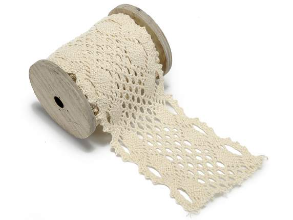 Lace ribbon on wooden reel