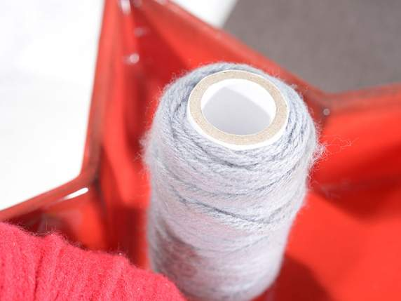 Roll of wire in coloured wool