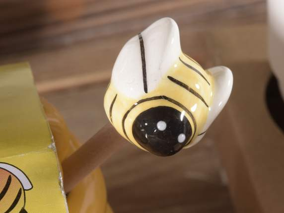 Ceramic honey tin with small wooden spoon