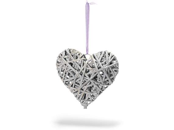 Grey wicker heart with violet ribbon.