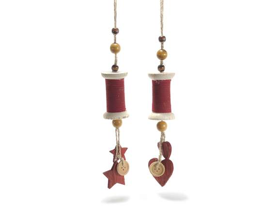 Hanging wooden reel w-red string and pendants